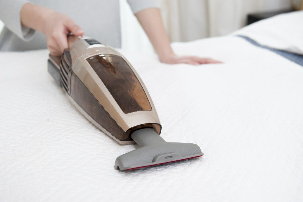 Person cleaning the mattress