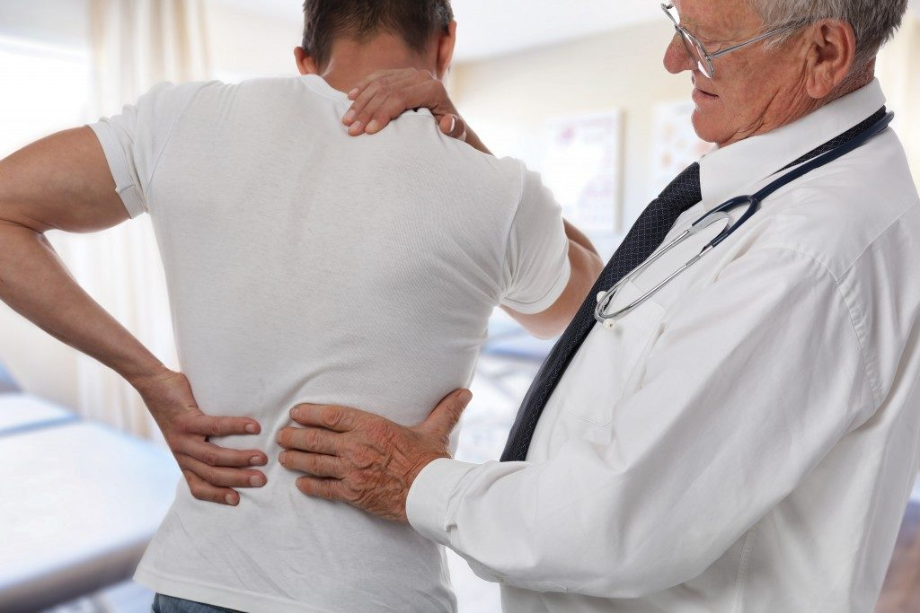 Letting the doctor check your back pain