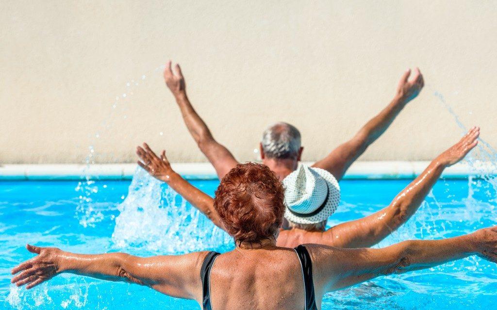 senior group doing water aerobics