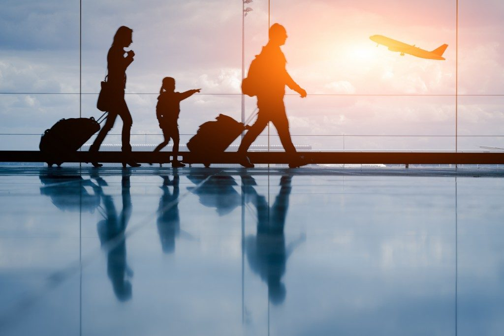 Silhouette of young family and airplane