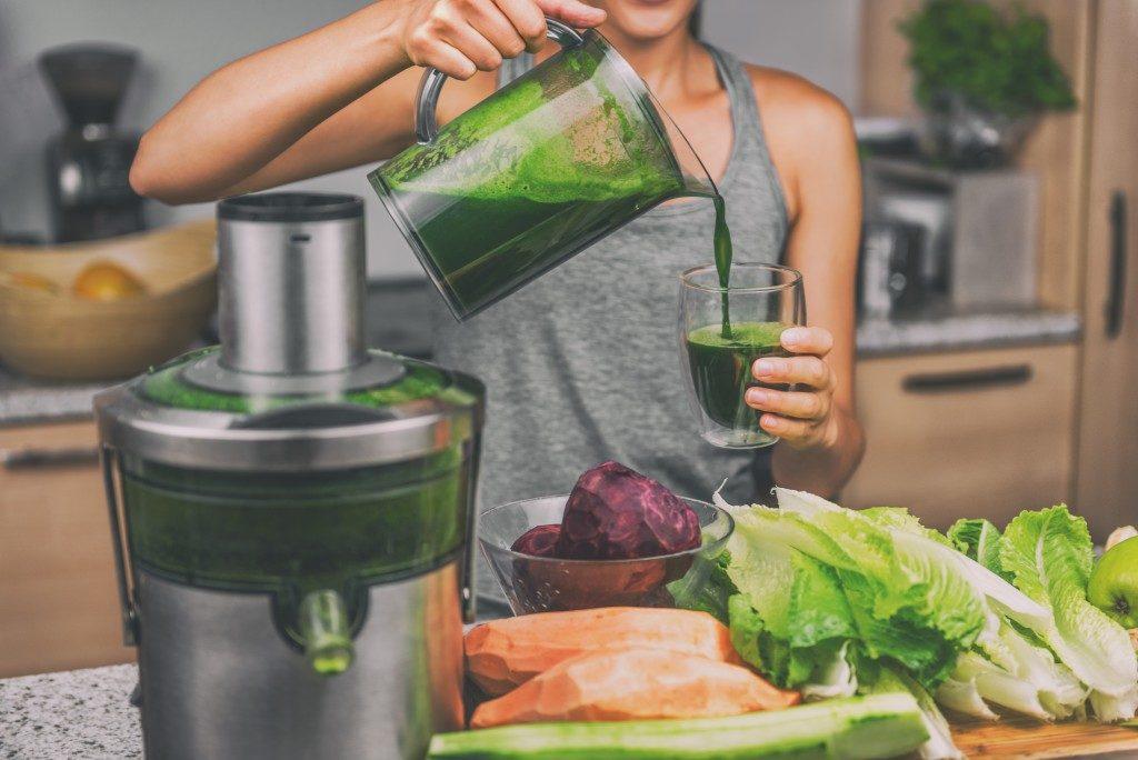 woman making healthy juice