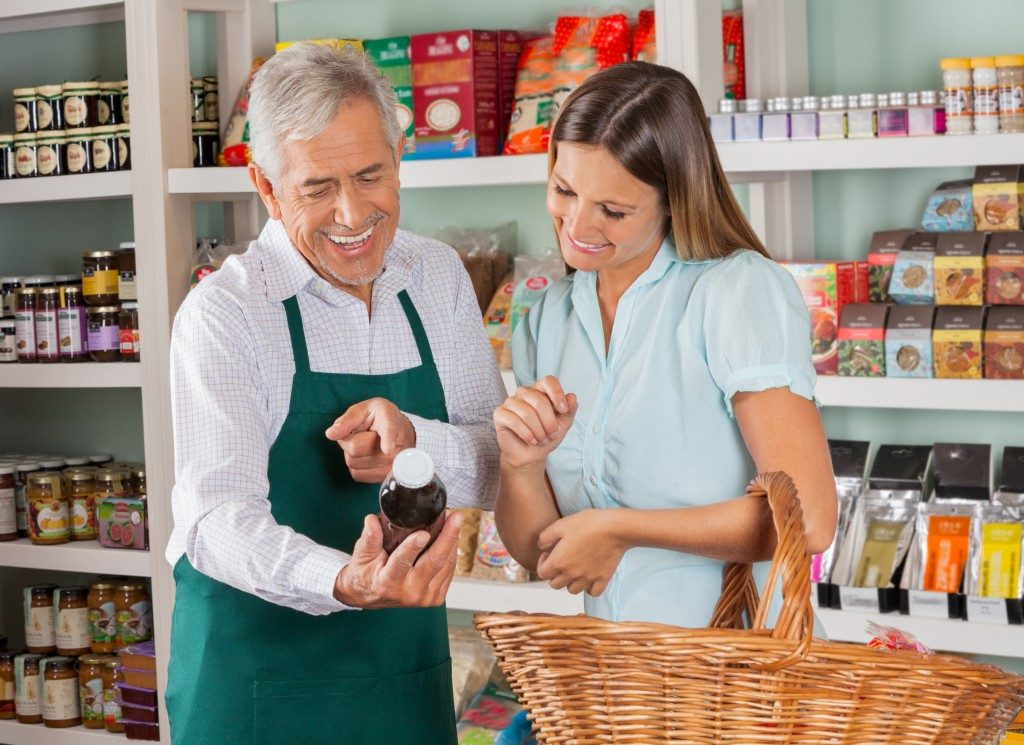 Grocery salesman with woman looking at a product