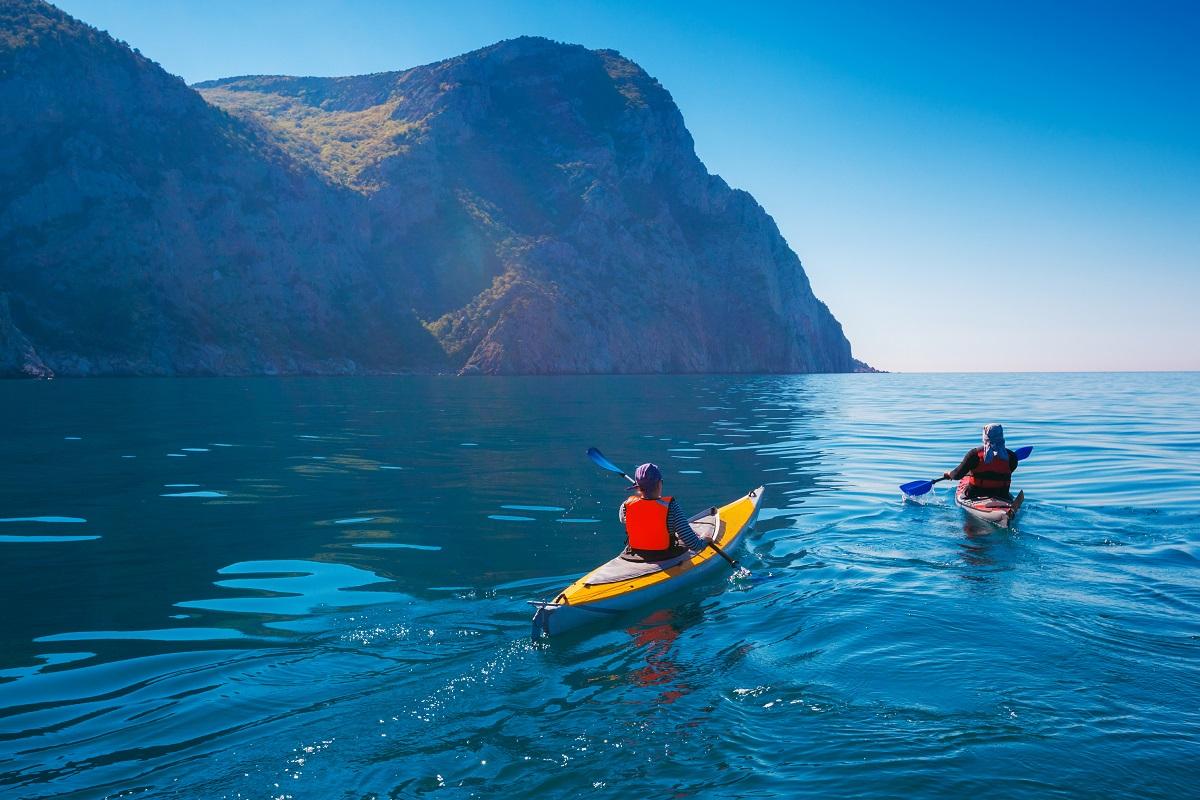Two people kayaking in lake