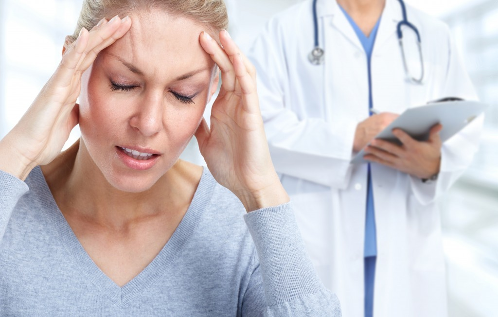 woman experiencing headache