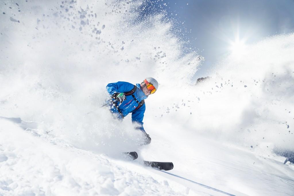 skiier along the mountain