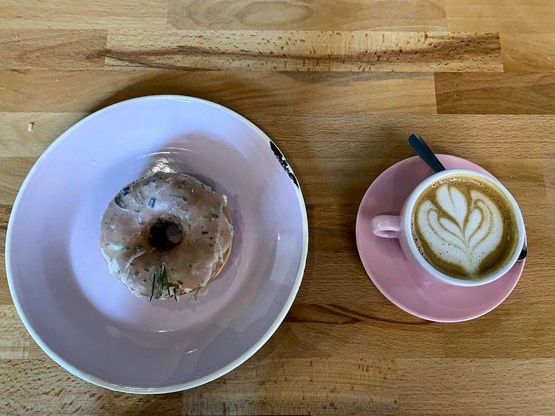 savory doughnut and a cup of coffee