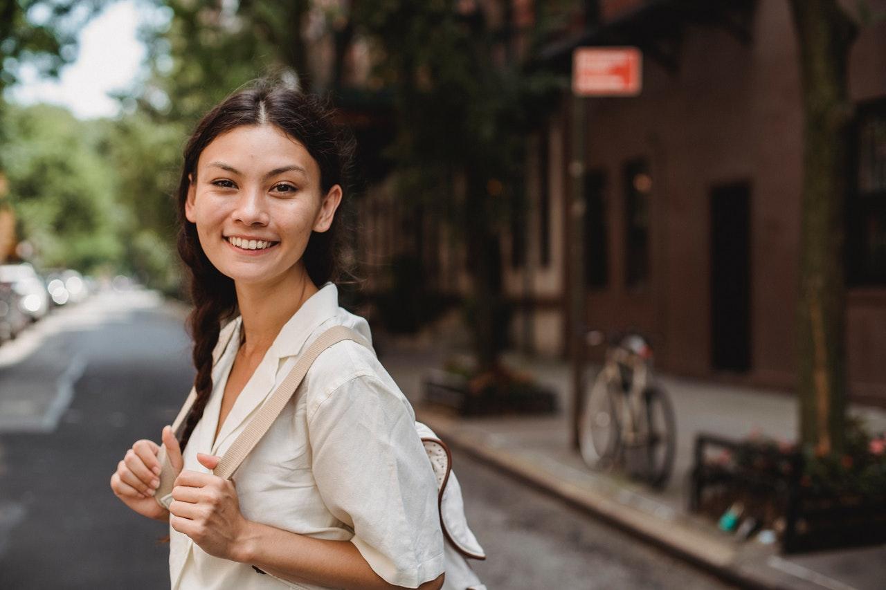 smiling traveling woman