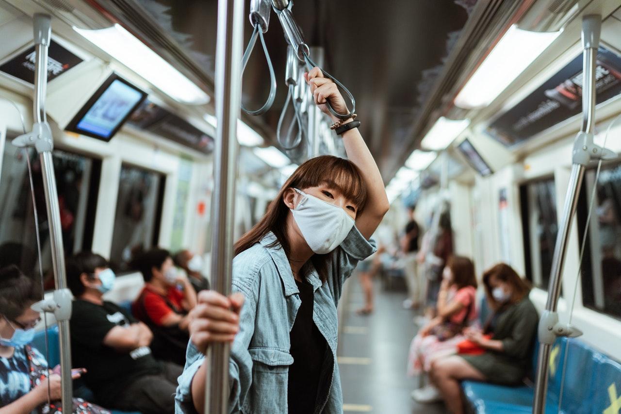 woman wearing face mask in public transportation