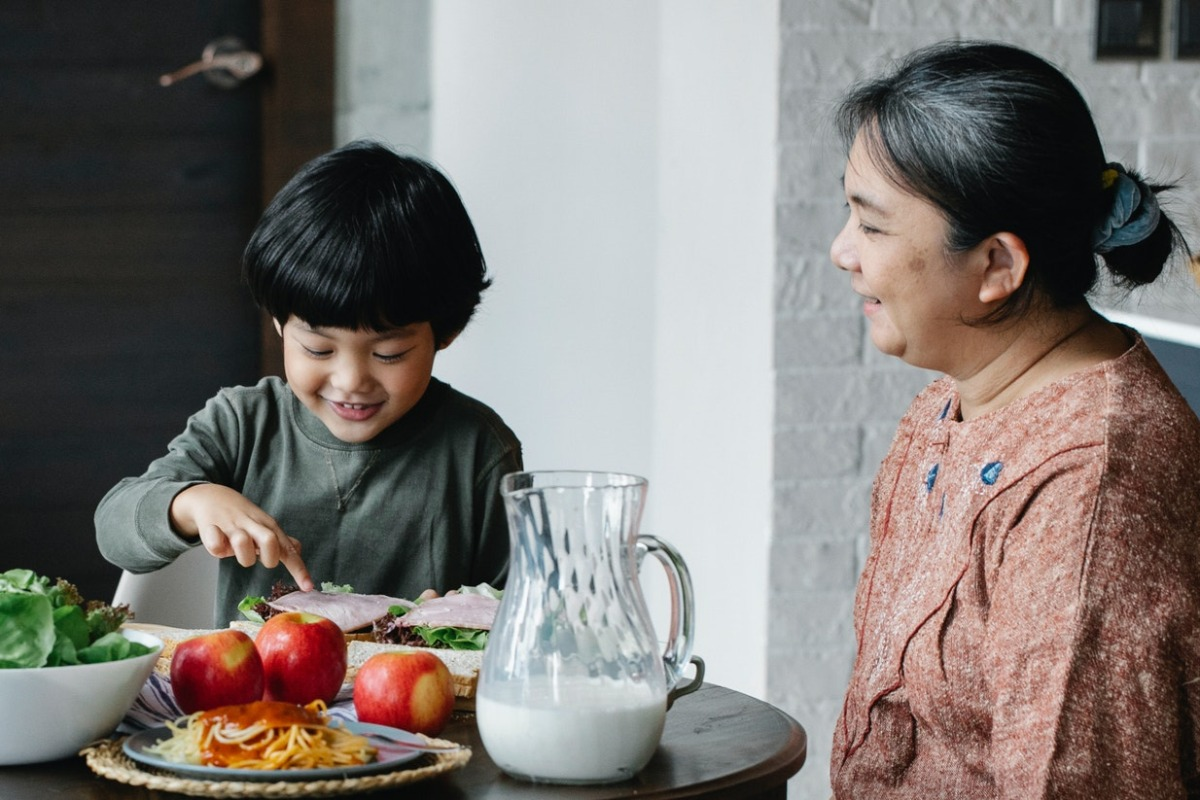 grandmother and grandson eating